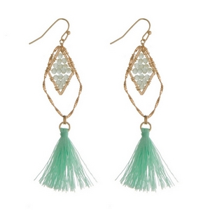 """Gold tone fishhook earrings with mint green beads and a fabric tassel. Approximately 3"""" in length."""