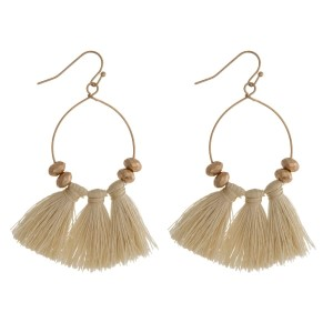 """Gold tone fishhook earrings with three ivory fabric tassels. Approximately 2"""" in length."""