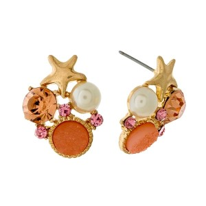 "Gold tone stud earrings with a starfish, peach stones, and a pearl bead. Approximately 3/4"" in length."