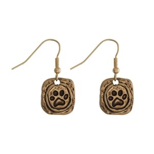 "Gold tone fishhook earrings with a paw print. Approximately 1/2"" in length."