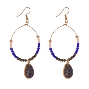 "Gold tone fishhook earrings with blue faceted beads and a teardrop sodalite natural stone. Approximately 3.5"" in length."