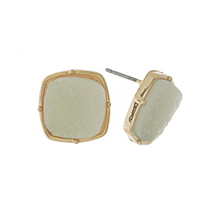 """Gold tone stud earrings with a mint green, square shaped faux druzy stone. Approximately 1/2"""" in length."""