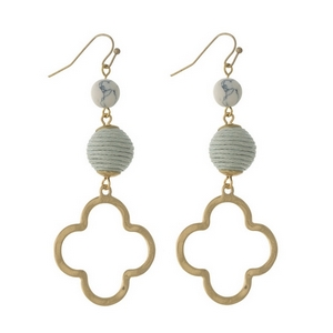 """Gold tone fishhook earrings with a gray thread wrapped bead and an open clover shape. Approximately 3"""" in length."""