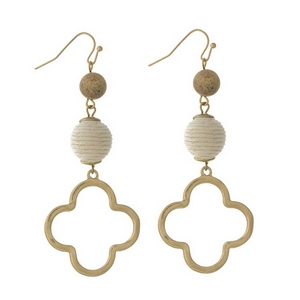 "Gold tone fishhook earrings with an ivory thread wrapped bead and an open clover shape. Approximately 3"" in length."