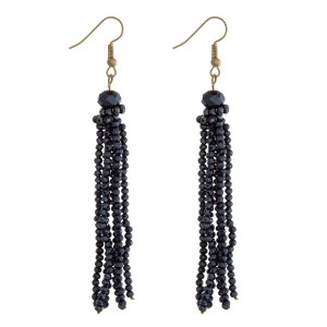 """Gold tone fishhook earrings with a navy blue faceted bead tassel. Approximately 3"""" in length."""
