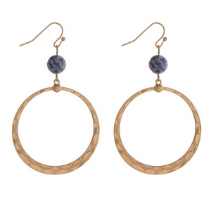 """Gold tone fishhook earrings with an open circle shape and a sodalite natural stone bead. Approximately 2.25"""" in length."""