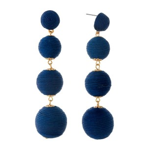 "Navy blue thread wrapped ball earrings with gold tone accents. Approximately 3.5"" in length."