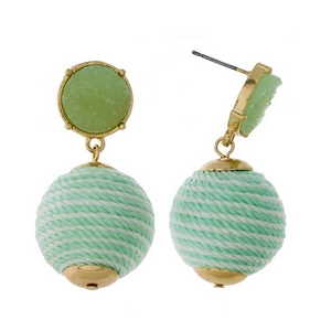 "Gold tone stud earrings with a mint green faux druzy stone and a white striped thread wrapped bead. Approximately 1.5"" in length."