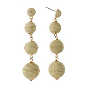 """Gold tone stud earrings with shimmering gold thread wrapped ball beads. Approximately 2.5"""" in length."""