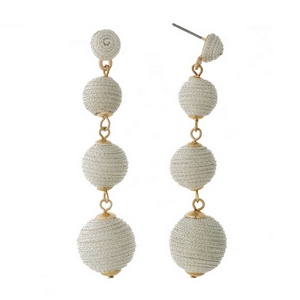 """Gold tone stud earrings with shimmering silver thread wrapped ball beads. Approximately 2.5"""" in length."""