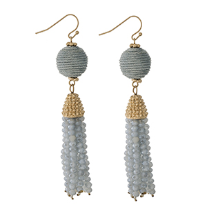 """Gold tone fishhook earrings with a gray thread wrapped bead and a beaded tassel. Approximately 3"""" in length."""