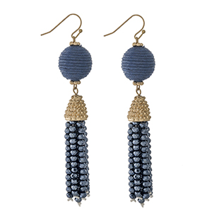 """Gold tone fishhook earrings with a navy blue thread wrapped bead and a beaded tassel. Approximately 3"""" in length."""