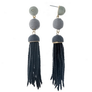 """Gold tone stud earrings with black ombre thread wrapped beads and a black tassel. Approximately 3.5"""" in length."""