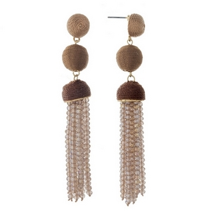 """Gold tone stud earrings with brown ombre thread wrapped beads and a champagne tassel. Approximately 3.5"""" in length."""