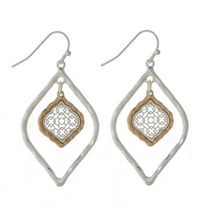 """Silver tone fishhook earrings with a two tone filigree oval shape. Approximately 1.5"""" in length."""