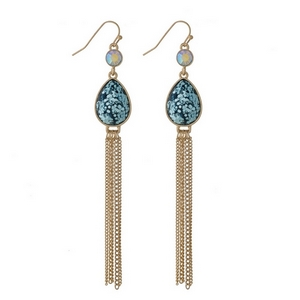 """Gold tone fishhook earrings with a light blue glitter teardrop and chain tassel. Approximately 4"""" in length."""