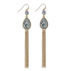 """Gold tone fishhook earrings with an iridescent glitter teardrop and chain tassel. Approximately 4"""" in length."""