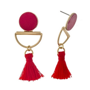 "Gold tone stud earrings with a red faux leather circle and a thread tassel. Approximately 2"" in length."