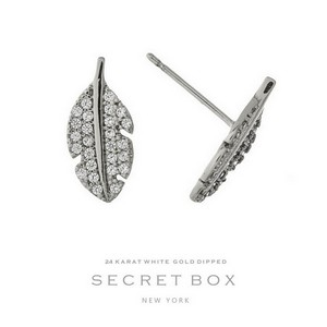 "Secret Box 24 karat white gold dipped over brass feather stud earrings. Approximately 2/3"" in diameter. Sold in a gift box."