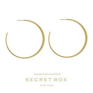 "Secret Box 14 karat gold dipped over brass flat hoop earrings. Approximately 2.5"" in diameter."