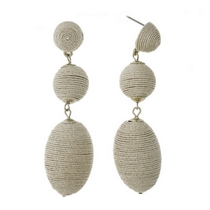 """Silver tone stud earrings with two thread wrapped beads. Approximately 3"""" in length."""