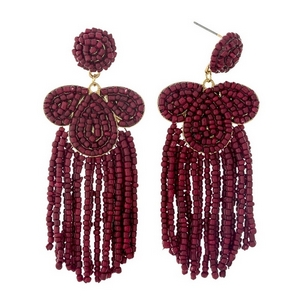 "Burgundy beaded statement earrings with beaded fringe. Approximately 3.25"" in length."