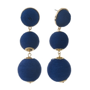 """Gold tone post style earrings with navy blue thread wrapped beads. Approximately 3"""" in length."""