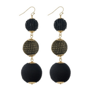 """Gold tone fishhook earrings with black thread wrapped and beaded, beads. Approximately 3.5"""" in length."""