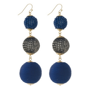 """Gold tone fishhook earrings with navy blue thread wrapped and beaded, beads. Approximately 3.5"""" in length."""