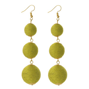 """Gold tone fishhook earrings with three metallic gold thread wrapped beads. Approximately 4"""" in length."""