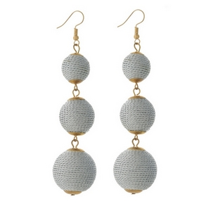 """Gold tone fishhook earrings with three metallic silver thread wrapped beads. Approximately 4"""" in length."""