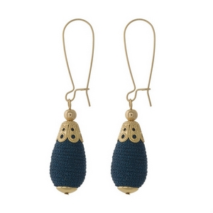 """Gold tone long hook earrings with a navy blue, thread wrapped, teardrop shaped bead. Approximately 2.5"""" in length."""