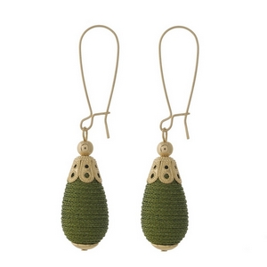 """Gold tone long hook earrings with an olive green, thread wrapped, teardrop shaped bead. Approximately 2.5"""" in length."""