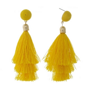 """Gold tone stud earrings with a yellow thread wrapped bead and tapered tassel. Approximately 3.5"""" in length."""