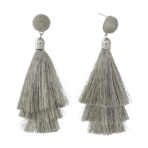 """Silver tone stud earrings with a silver thread wrapped bead and tapered tassel. Approximately 3.5"""" in length."""