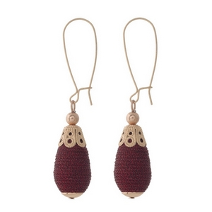"""Rose gold tone long hook earrings with a burgundy, thread wrapped, teardrop shaped bead. Approximately 2.5"""" in length."""