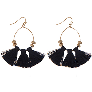 """Gold tone fishhook earrings with three navy blue fabric tassels. Approximately 2"""" in length."""