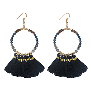 "Gold tone fishhook earrings with a natural stone beaded circle, accented with black thread tassels. Approximately 3"" in length."