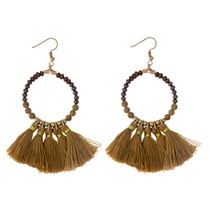 """Gold tone fishhook earrings with a natural stone beaded circle, accented with tan thread tassels. Approximately 3"""" in length."""