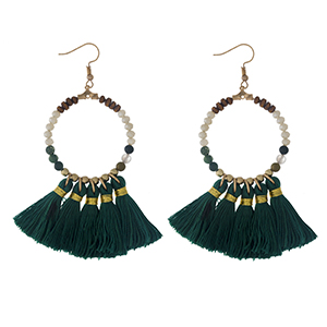 """Gold tone fishhook earrings with a natural stone beaded circle, accented with green thread tassels. Approximately 3"""" in length."""