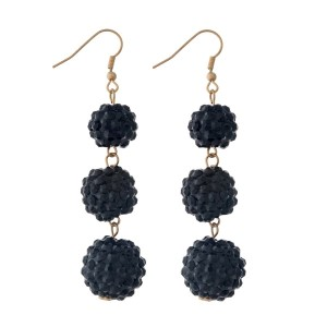 """Gold tone fishhook earrings with three, black pave rhinestone beads. Approximately 3"""" in length."""