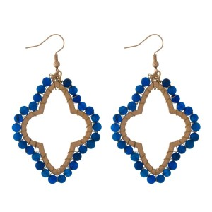 "Gold tone, open moroccan shaped, fishhook earrings with wire wrapped blue natural stones. Approximately 2"" in length."