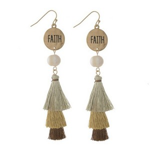 "Fishhook earrings with a circle shape stamped with ""Faith"" and a tiered metallic tassel. Approximately 3.5"" in length."