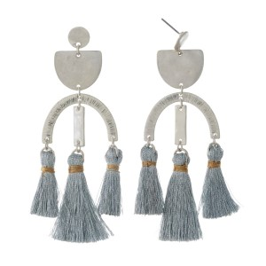 "Silver tone post style earrings with hammered geometric shapes and three tassels. Approximately 3.25"" in length."