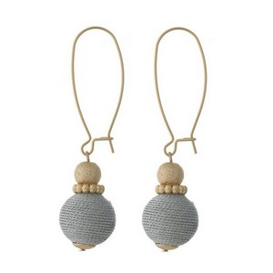 """Gold tone, drop earrings with a metallic thread bead. Approximately 2"""" in length."""