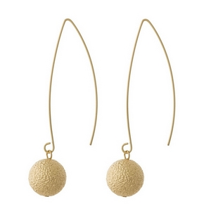 """Dainty, long hook earrings with a textured bead on the end. Approximately 2.5"""" in length."""