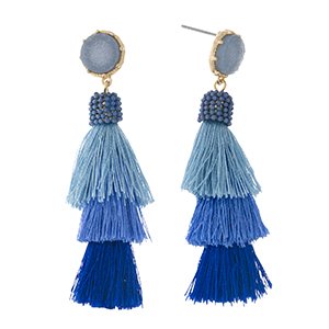 "Gold tone stud earrings with a faux druzy stone and a blue ombre, tiered, thread tassel. Approximately 2.5"" in length."