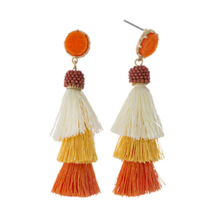 "Gold tone stud earrings with a faux druzy stone and an orange ombre, tiered, thread tassel. Approximately 2.5"" in length."