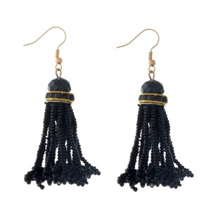"Gold tone fishhook earrings with a black, seed-bead tassel. Approximately 2"" in length."