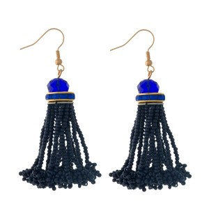 "Gold tone fishhook earrings with a navy blue, seed-bead tassel. Approximately 2"" in length."